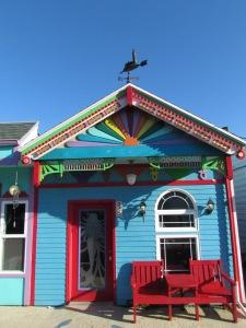 Rainbow house with a mermaid door