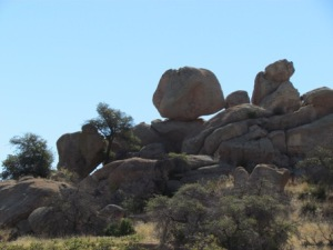 Looks like someone carefully placed that rock on top of those other rocks, doesn't it?