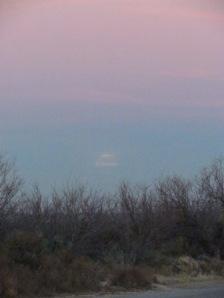 barely visible rising moon