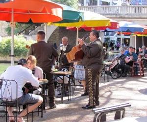 mariachi band serenading a family